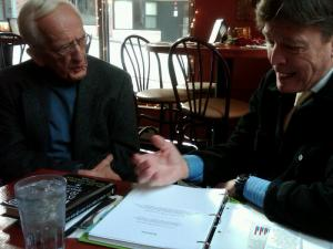 "Dr. T. Colin Campbell and J. Morris Hicks review the manuscript of ""Healthy Eating - Healthy World"" after eating a ""4-Leaf"" meal next to the Cornell campus in December of 2010"