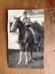8-year old Jim Hicks on his wonderful horse Buttons outside his home in Greenville, Mississippi