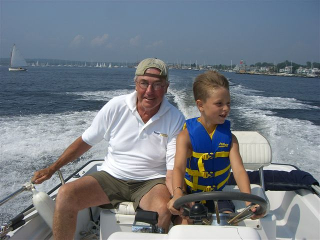 "In the summer of 2009, my oldest grandson, Collin (7), stayed with me for a week while he was here for ""sailing camp"" at the SHYC foundation. In his thoughtful and generous manner (as always), Mike asked Collin (at breakfast) if he'd like to take a motorboat ride that afternoon. Naturally, he responded in a gleeful affirmative. A few hours later, as the fog lifted, the three of us enjoyed a spirited tour of Stonington Harbor---with young Collin at the helm."