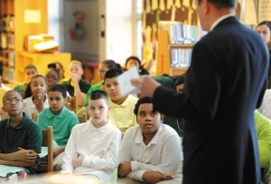 J. Morris Hicks speaking to the sixth graders in New London, CT