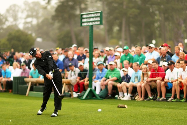"Gary Player rips a beautiful drive down the first fairway as the ""big three"" all serve as honorary starters of The Masters"