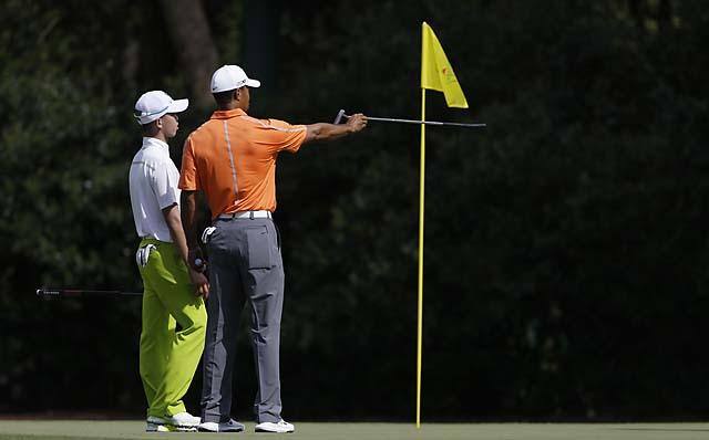 4-time champion Tiger Woods gives some pointers to the youngster, Tianlang Guan.