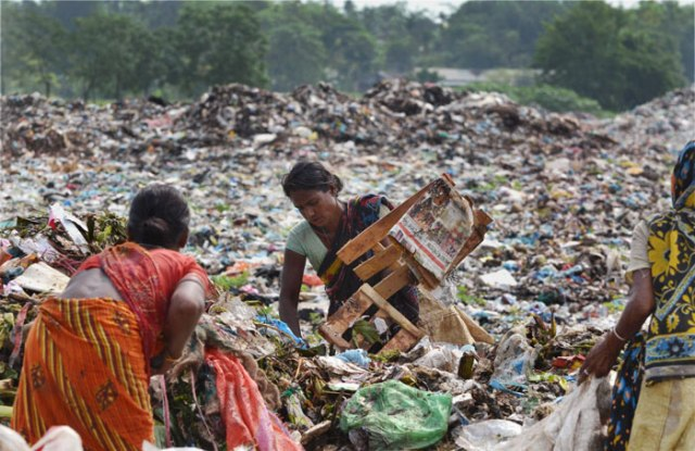Women search for recyclable items among heaps of rubbish at a municipal waste dumping site on World Environment Day in Dimapur, Nagaland.