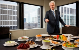 Bill Clinton about to enjoy a plant-based lunch in his Manhattan office. (Photo from the AARP article)